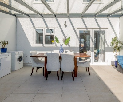 Sunroom with White Tiles